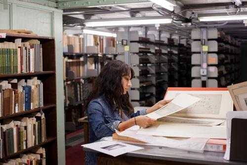 researcher viewing materials in the architecture special collections