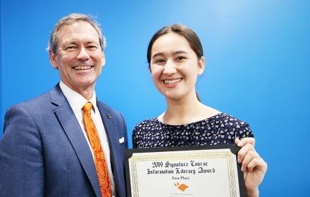 Grace Nguyen with Undergraduate Studies Dean Brent Iverson