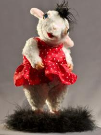 sheep doll dressed in red polka dot dress